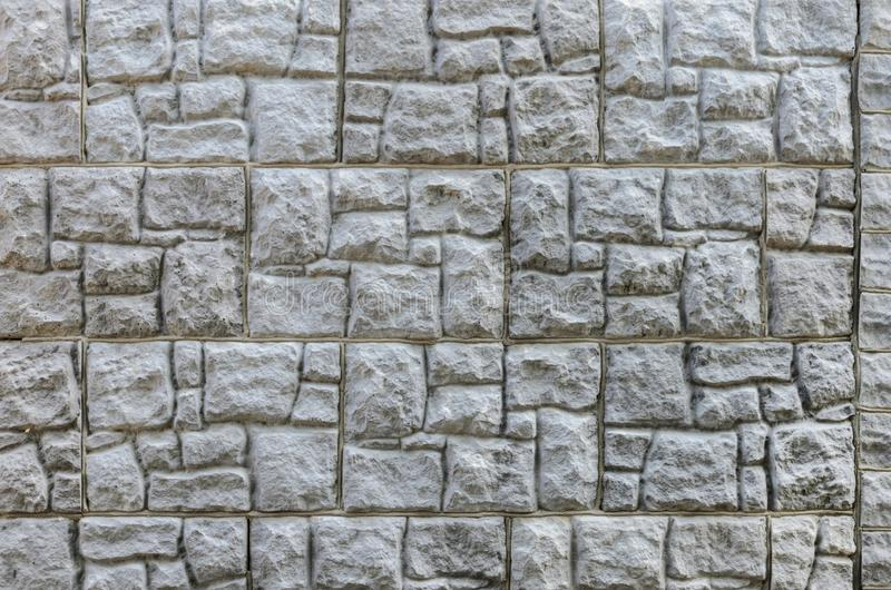 Wall made of artificial stone. Finishing the facade of the building. Texture. Wall made of artificial stone. Finishing the facade of the building royalty free stock image