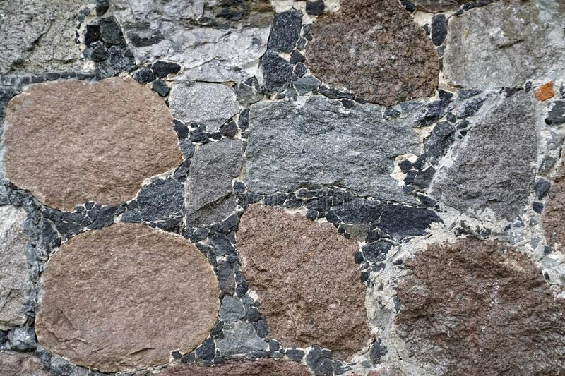 Wall texture with closeup of chipped stone. Mineral granite. Chaos and order  rough surface relief royalty free stock image