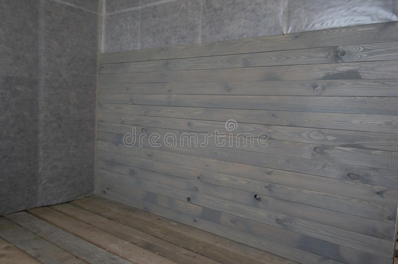 The walls of a frame house with clapboard. The walls of a frame house painted paneling stock images