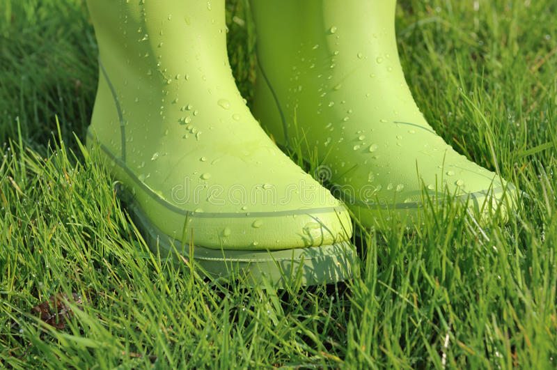 Water drops on rubber boots stock image