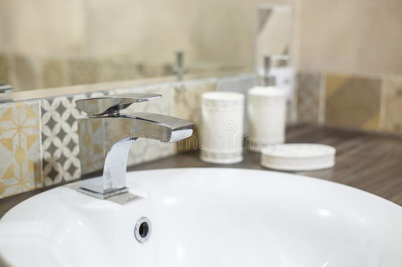Water tap sink with faucet in expensive loft bathroom.  stock photos