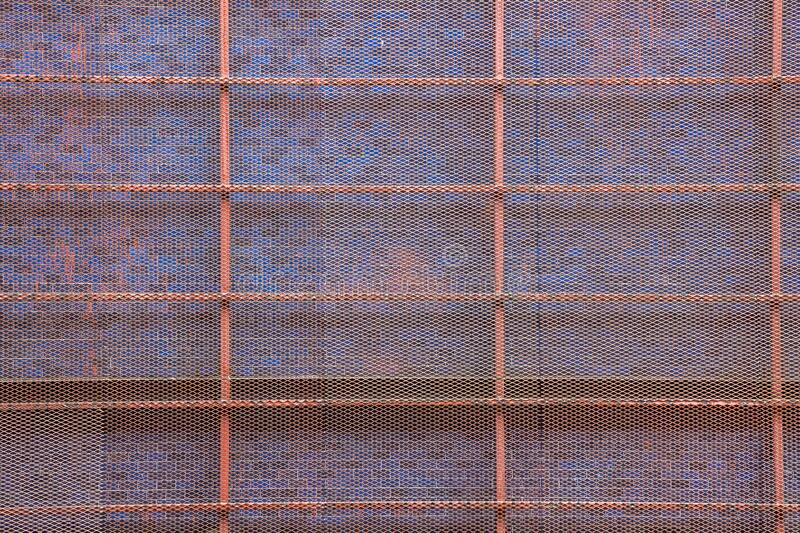 Welded Metal Steel Wall Mesh Netting outside Building Construction, Decoration Background. Safety, Security, Pet or Poultry Run,. Fall Prevention, Burglary stock photos