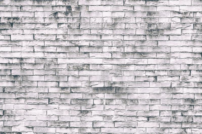 White brick wall background in rural room. Loft style wall use for background or texture royalty free stock image