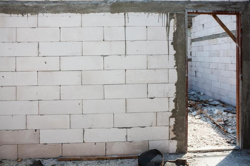 White brick wall and Door jamb installation. In concrete wall of construction royalty free stock images