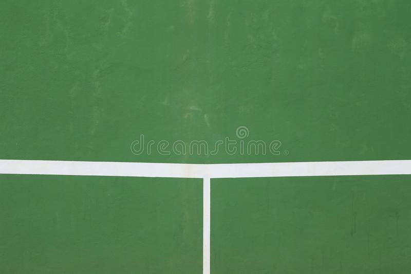 White lines of tennis courts on green floor background. royalty free stock images