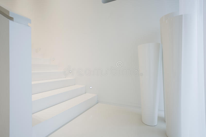 White staircase inside pure house stock photos