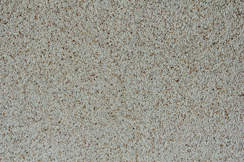 White stone chippings wall. Texture and background stock photography