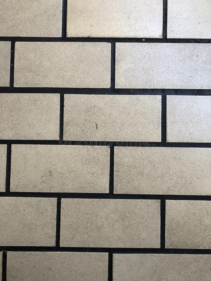 White. Tile with black grout in order stock image