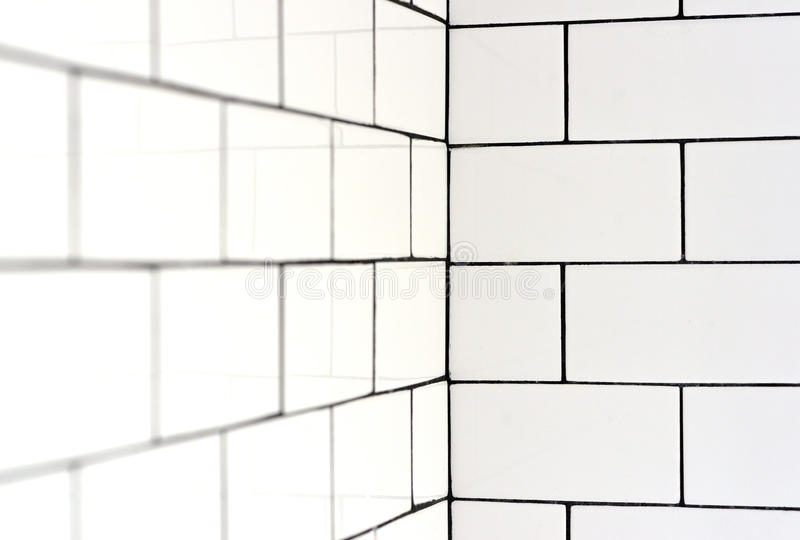 White vintage metro tiles. And black grout in a bathroom stock photography