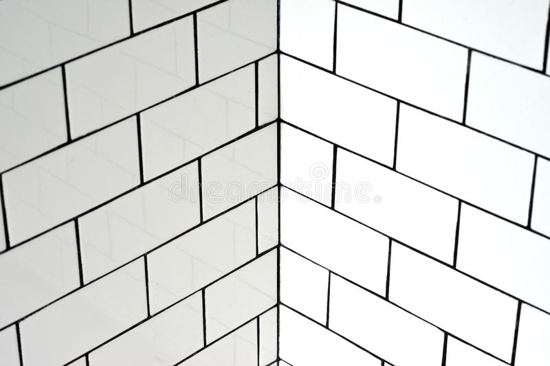 White vintage metro tiles. And black grout in a bathroom stock photo