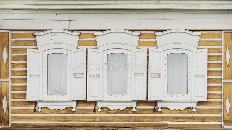 White wooden windows with shutters of an old village house stock images