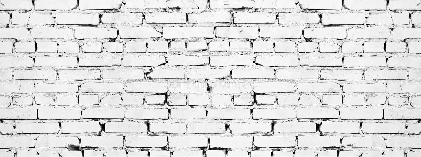 Wide white brick wall texture. Aged rough whitewashed brickwork. Grunge background. Wide white brick wall texture. Old rough whitewashed brickwork. Grunge royalty free stock photos