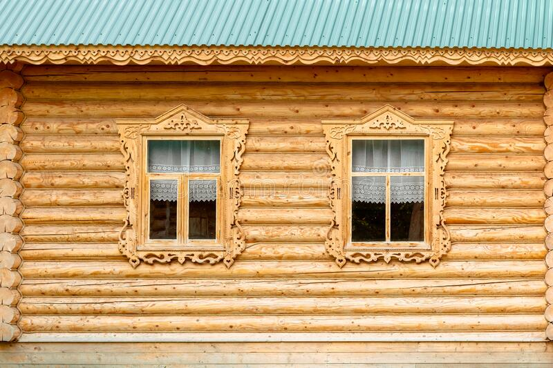 Window in the old house. wooden house. Russian hut. stock photography