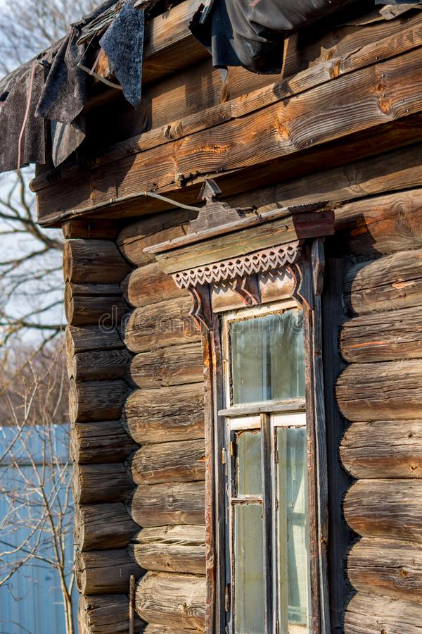 Window of the old village hut in the Russian village. Close royalty free stock images