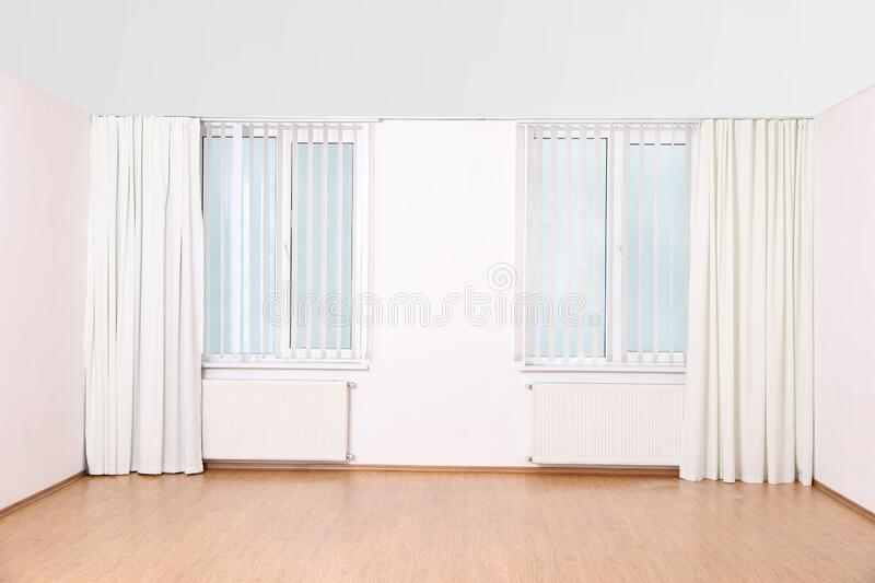 Windows with curtains and blinds in empty room royalty free stock image