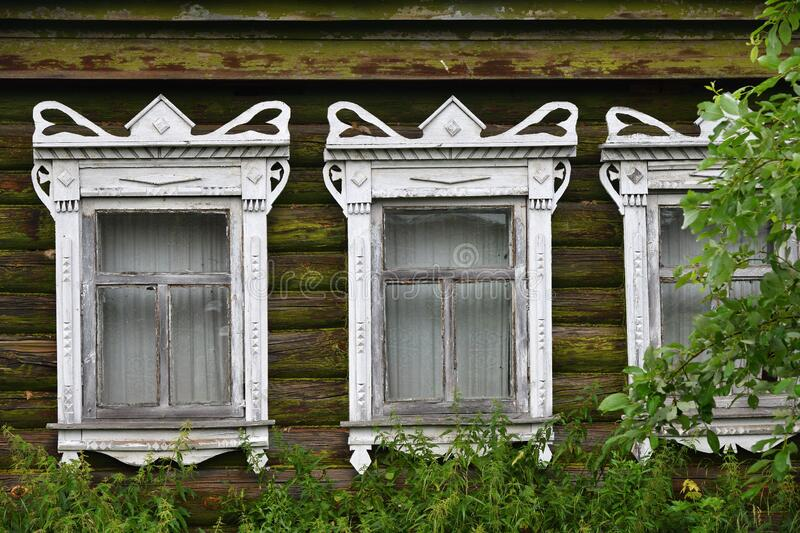Windows of a typical old russian wooden log house.  Russia royalty free stock photos