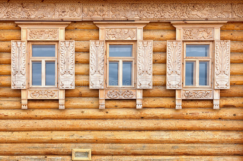 Windows on the wooden house facade. Old Russian country style. The windows on the facade of the wooden house. Old Russian country style royalty free stock photo