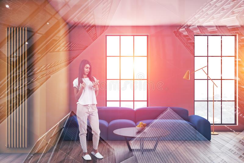 Woman with phone in yellow and pink living room stock image