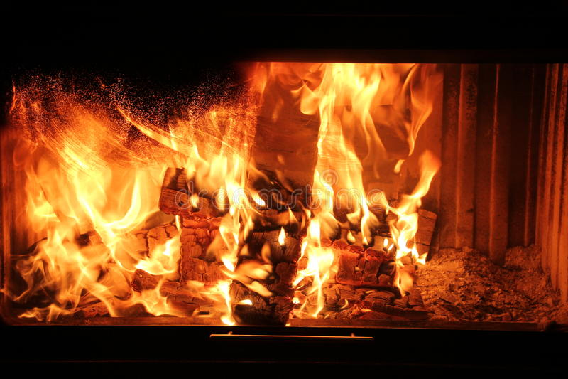 Wood burning in the fireplace red coals royalty free stock images