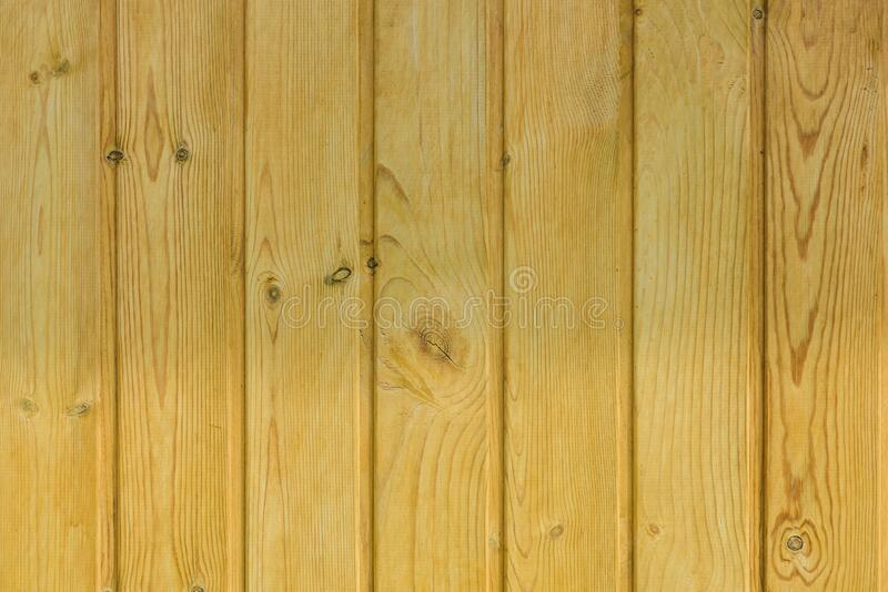 Wooden background, close-up. Light tinted pine clapboard. Materials for construction and finishing works.  royalty free stock image