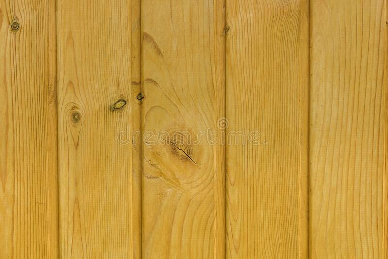Wooden background, close-up. Light tinted pine clapboard. Materials for construction and finishing works.  stock images