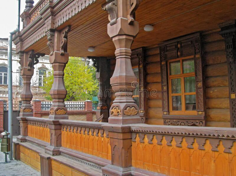Wooden Building in The Old Russian Style. Carved Patterns and Delicate Details Create a Unique Building Design stock images