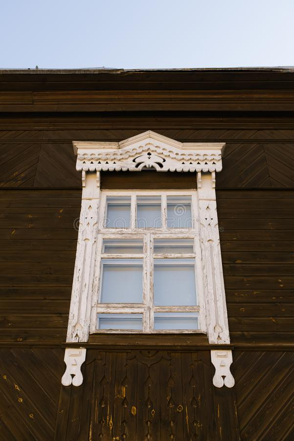Carved window frame in a wooden Russian house royalty free stock image