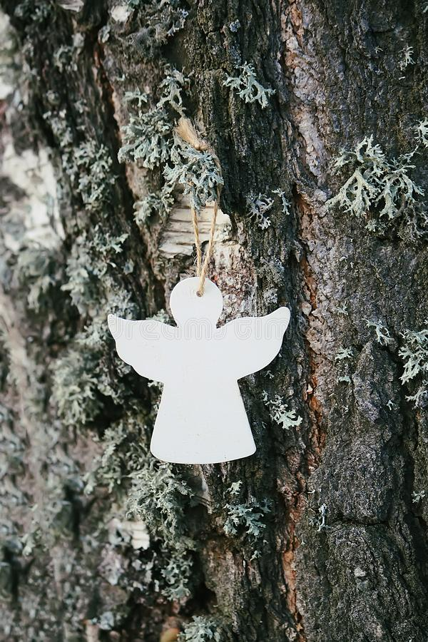 Wooden decoration angel white figure on tree bark stock photos