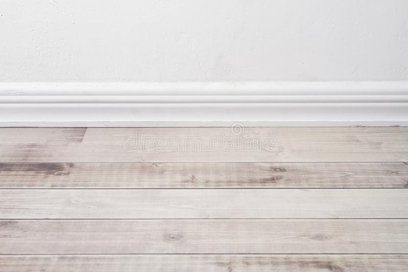Wooden floor and plaster skirting board. royalty free stock photos