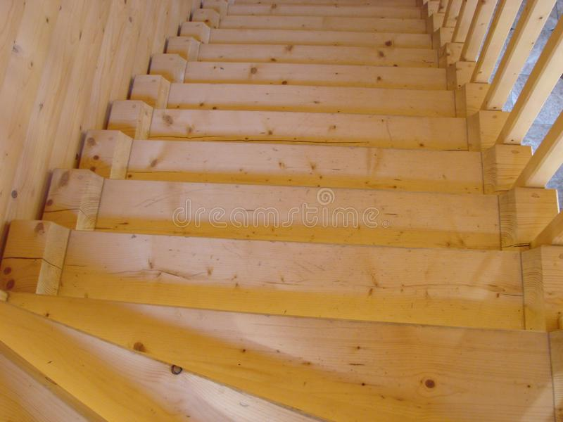 Wooden interior staircase to second floor royalty free stock photo