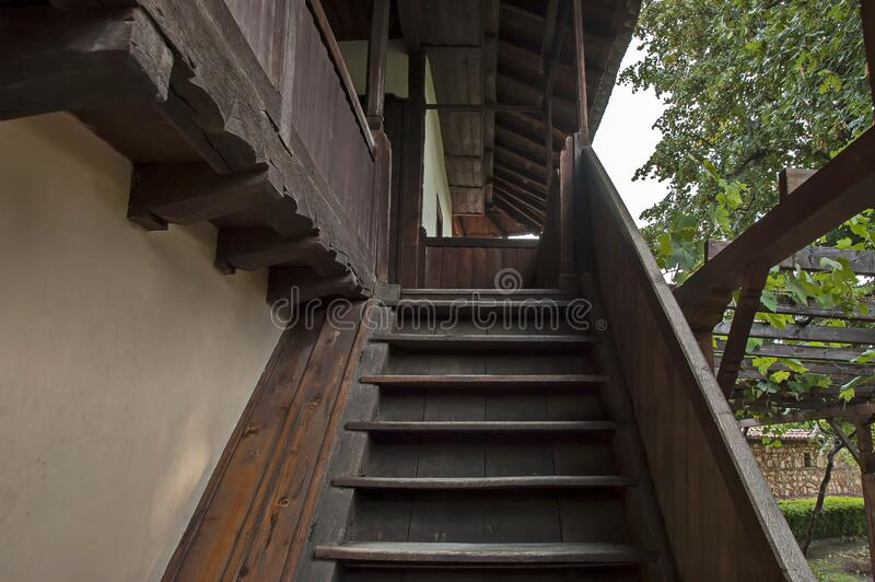 A wooden staircase to the entrance of the second floor of an old Bulgarian house stock photo