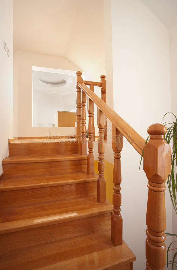 Wooden stairs. In house, interior decoration, wood and white walls stock photos
