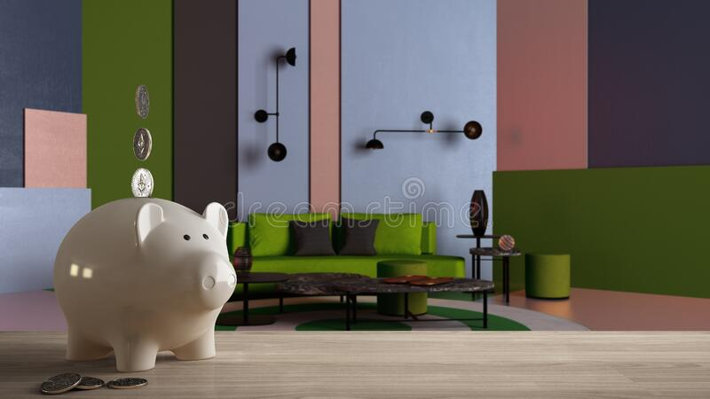 Wooden table top or shelf with white piggy bank with coins, colorful living room, green sofa, pouf, expensive home interior design. Renovation restructuring royalty free stock photos
