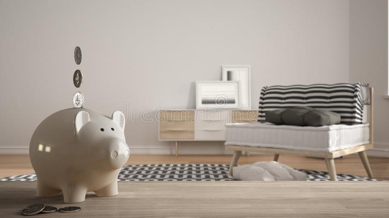Wooden table top or shelf with white piggy bank with coins, modern white and wooden living room, expensive home interior design, stock image