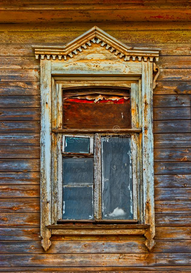 Wooden window carved frame of wooden lacy in Astrakhan Russia royalty free stock photography