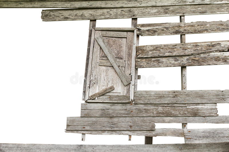 Wooden windows decayed. Isolates gap wooden walls and windows of old houses decayed royalty free stock images