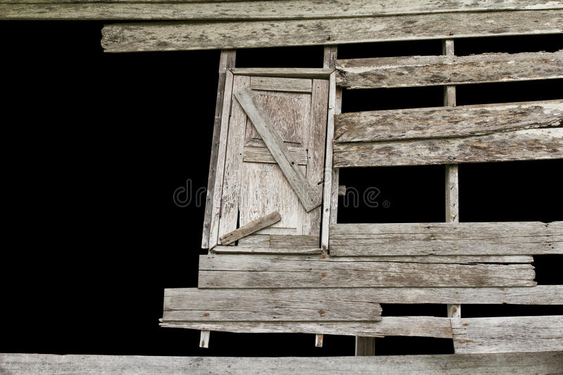 Wooden windows decayed. Isolates gap wooden walls and windows of old houses decayed royalty free stock photos