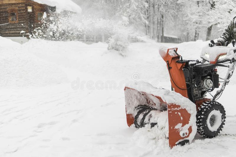 The worker removes the snow with a plow. Landscape in winter, Ru royalty free stock photography