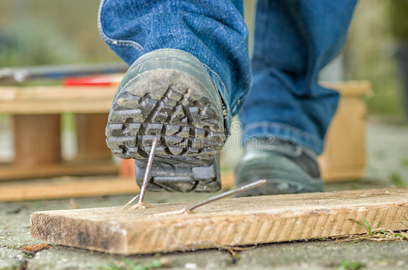 Worker with safety shoes stock photos