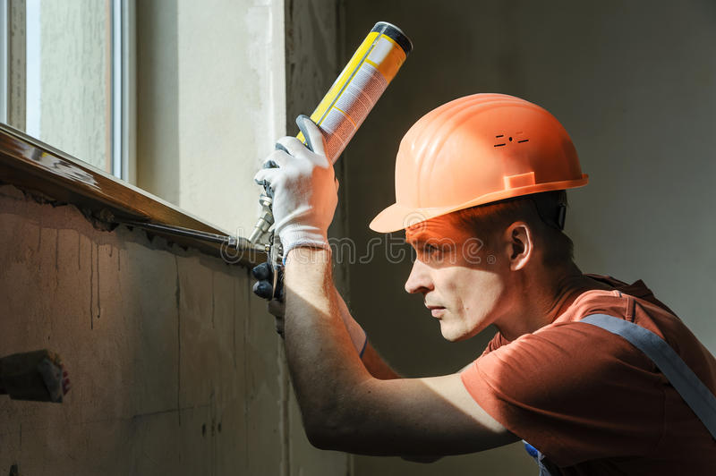 Worker is using a polyurethane foam. royalty free stock photos