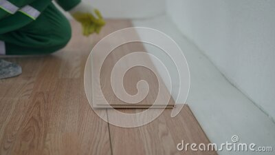 Carpenter laying laminate floor. Laying laminate flooring stock video