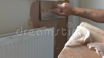 Plasterer applying second coat of plaster stock video