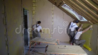 Plastering mortar machine. Automatic plaster. Repairing or renovating house or apartment. Builder at construction stock video footage