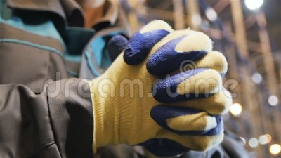 Slow Motion Closeup Worker in Gloves Claps his Hands stock video footage