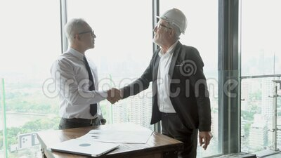 Two senior man engineer discussing about project and planning work is teamwork stock video