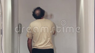 Worker painting with white paint stock footage