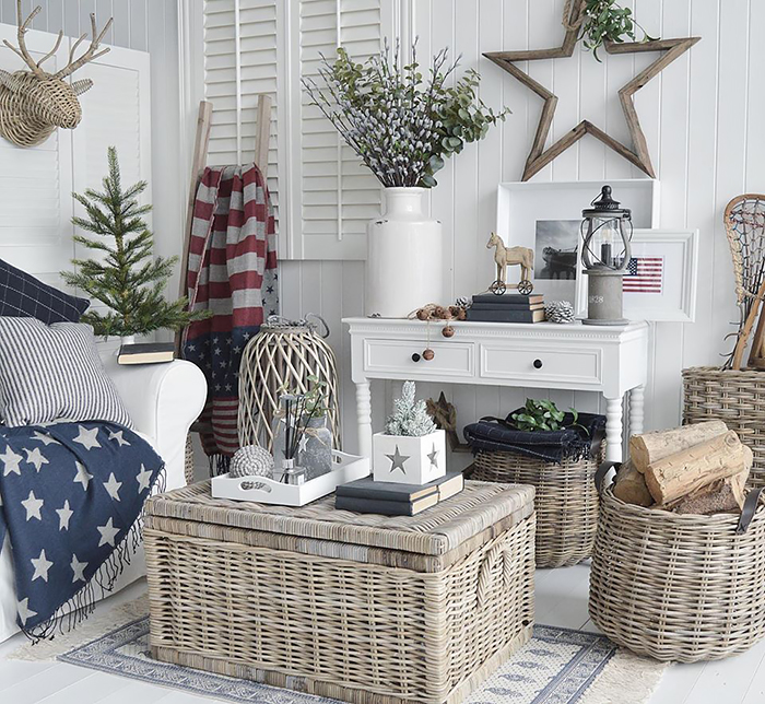 New England white furniture. Shows the white console table with two drawers as a sofa table in the white living room with accents of colour and stars and stripes